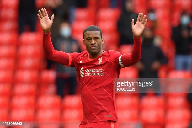 Liverpool's Dutch midfielder Georginio Wijnaldum leaves the pitch after being substituted off during the English Premier League football match...