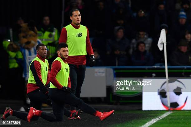 Liverpool's Dutch midfielder Georginio Wijnaldum Liverpool's English midfielder Alex OxladeChamberlain and Liverpool's Dutch defender Virgil van Dijk...