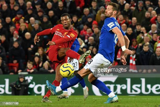 Liverpool's Dutch midfielder Georginio Wijnaldum scores his team's fifth goal during the English Premier League football match between Liverpool and...