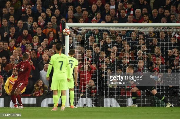 Liverpool's Dutch midfielder Georginio Wijnaldum scores their third goal during the UEFA Champions league semifinal second leg football match between...