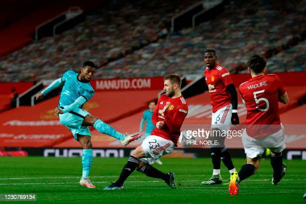 Liverpool's Dutch midfielder Georginio Wijnaldum shoots at goal during the English FA Cup fourth round football match between Manchester United and...