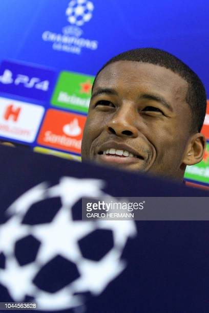 Liverpool's Dutch midfielder Georginio Wijnaldum smiles during a press conference on the eve of the UEFA Champions League Group C football match...