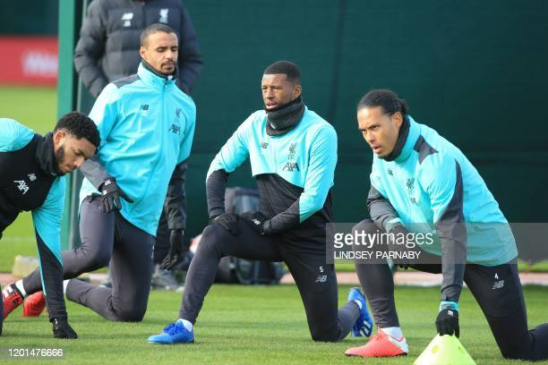 Liverpool's Dutch midfielder Georginio Wijnaldum stretches during a training session at Melwood in Liverpool north west England on February 17 on the...