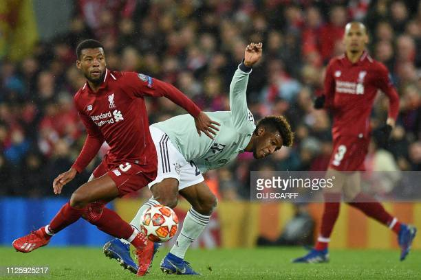 Liverpool's Dutch midfielder Georginio Wijnaldum vies with Bayern Munich's French forward Kingsley Coman during the UEFA Champions League round of 16...