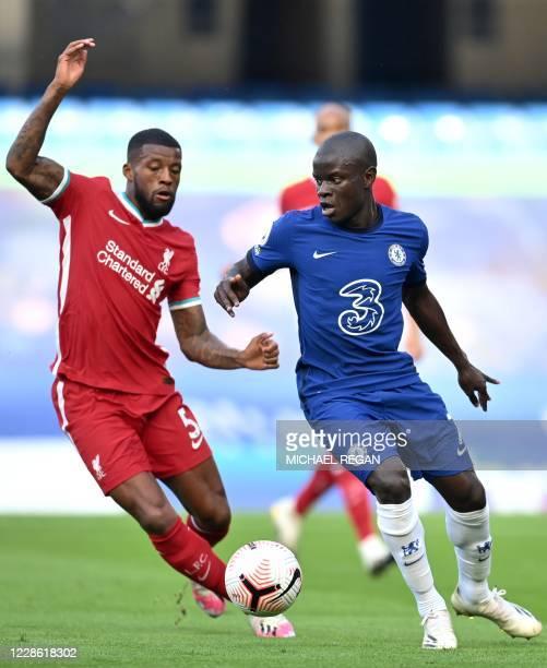 Liverpool's Dutch midfielder Georginio Wijnaldum vies with Chelsea's French midfielder N'Golo Kante during the English Premier League football match...