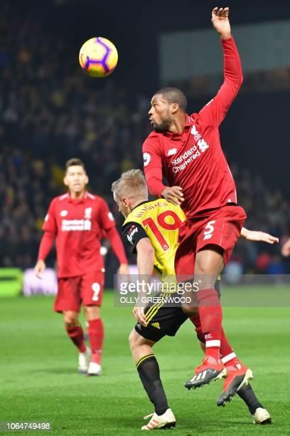 Liverpool's Dutch midfielder Georginio Wijnaldum vies with Watford's English midfielder Will Hughes during the English Premier League football match...