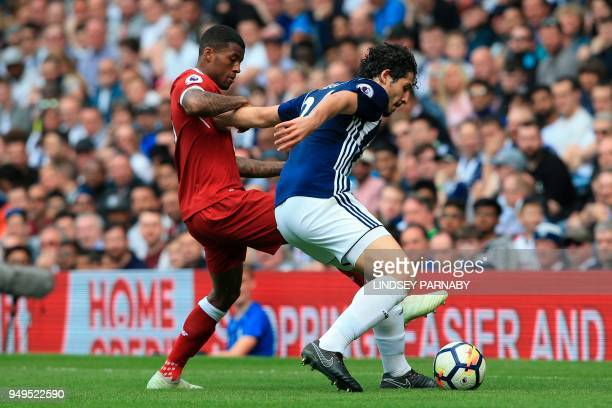 Liverpool's Dutch midfielder Georginio Wijnaldum vies with West Bromwich Albion's Egyptian defender Ahmed Hegazy during the English Premier League...