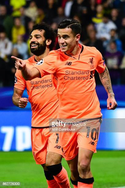 Liverpool's Egyptian forward Mohamed Salah and Brazilian midfielder Philippe Coutinho celebrate after scoring a goal during the UEFA Champions League...