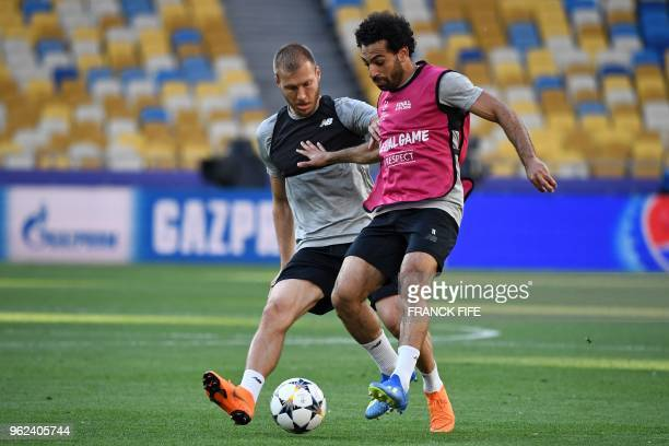 Liverpool's Egyptian forward Mohamed Salah and Liverpool's Estonian defender Ragnar Klavan take part in a Liverpool team training session at the...