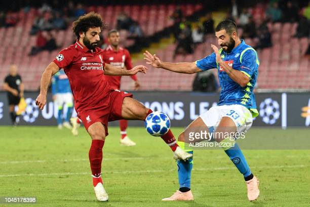 Liverpool's Egyptian forward Mohamed Salah and Napoli's Spanish defender Raul Albiol go for the ball during the UEFA Champions League group C...