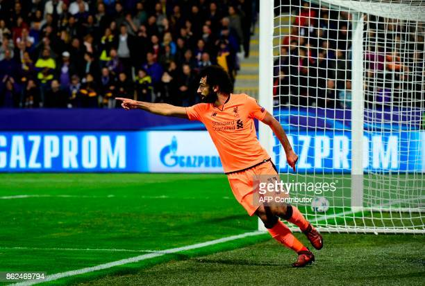 Liverpool's Egyptian forward Mohamed Salah celebrates after scoring a goal during the UEFA Champions League group E football match between NK Maribor...