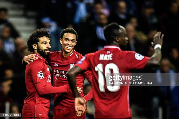 Liverpool's Egyptian forward Mohamed Salah celebrates his goal with teammates Liverpool's British defender Trent AlexanderArnold and Liverpool's...