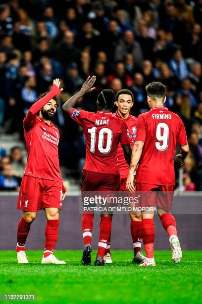 Liverpool's Egyptian forward Mohamed Salah celebrates his goal with teammates during the UEFA Champions League quarterfinal second leg football match...