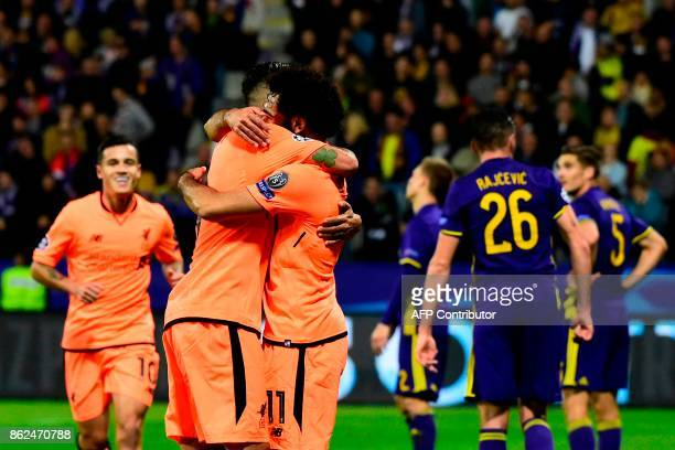Liverpool's Egyptian forward Mohamed Salah celebrates with teammates after scoring a goal during the UEFA Champions League group E football match...