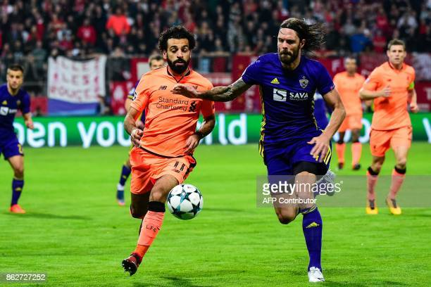 Liverpool's Egyptian forward Mohamed Salah fights for the ball with NK Maribor's Slovenian defender Marko Suler during the UEFA Champions League...