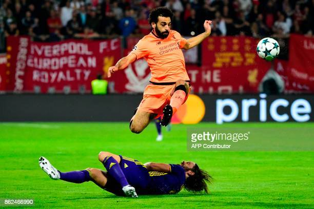 Liverpool's Egyptian forward Mohamed Salah jumps over Maribor's Slovenian defender Marko Suler during the UEFA Champions League group E football...