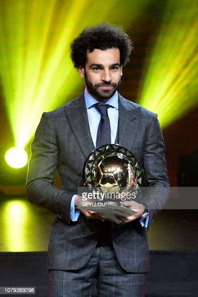 Liverpool's Egyptian forward Mohamed Salah poses with the 2018 African Footballer of the Year Award also called Ballon d'Or during an award ceremony...