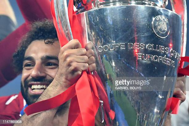 Liverpool's Egyptian forward Mohamed Salah raises the European Champion Clubs' Cup after winning the UEFA Champions League final football match...