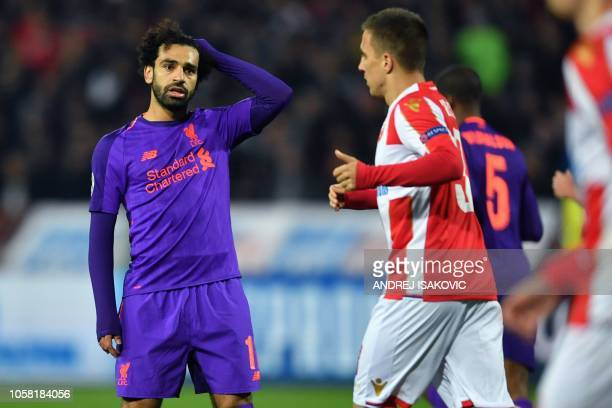 Liverpool's Egyptian forward Mohamed Salah reacts during the UEFA Champions League Group C secondleg football match between Red Star Belgrade and...