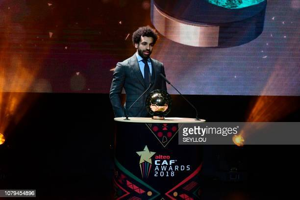 Liverpool's Egyptian forward Mohamed Salah speaks on stage with the 2018 African Footballer of the Year Award also called Ballon d'Or during the CAF...
