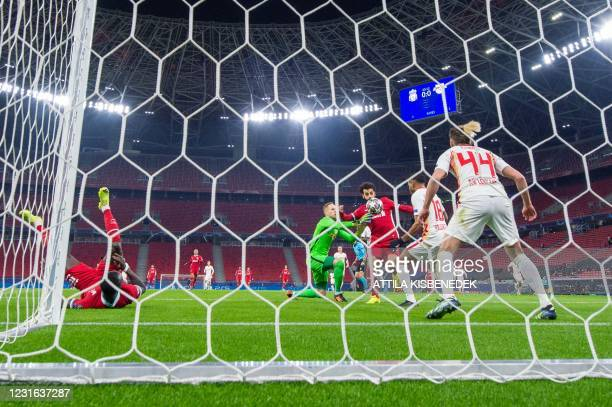 Liverpool's Egyptian forward Mohamed Salah vies with RB Leipzig's Hungarian goalkeeper Peter Gulacsi , RB Leipzig's French midfielder Christopher...