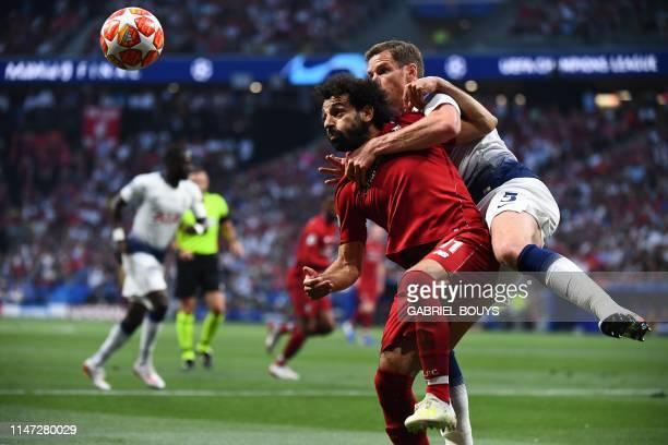 TOPSHOT Liverpool's Egyptian forward Mohamed Salah vies with Tottenham Hotspur's Belgian defender Jan Vertonghen during the UEFA Champions League...