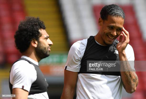 Liverpool's Egyptian midfielder Mohamed Salah and Liverpool's Dutch defender Virgil van Dijk attends a training session and media day at Anfield...