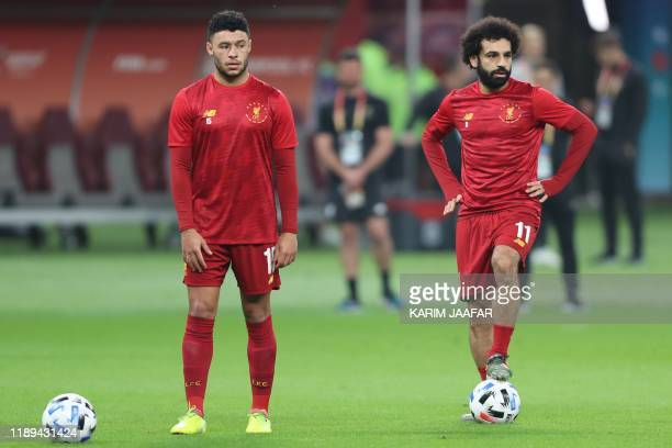 Liverpool's Egyptian midfielder Mohamed Salah and Liverpool's English midfielder Alex Oxlade-Chamberlain warm up ahead of the 2019 FIFA Club World...