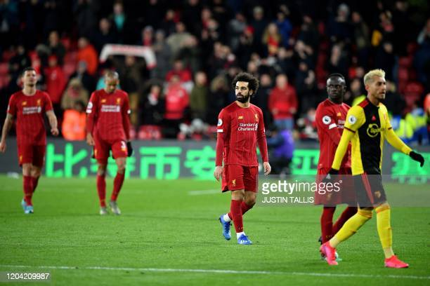 Liverpool's Egyptian midfielder Mohamed Salah and Liverpool's Senegalese striker Sadio Mane react at the final whistle during the English Premier...
