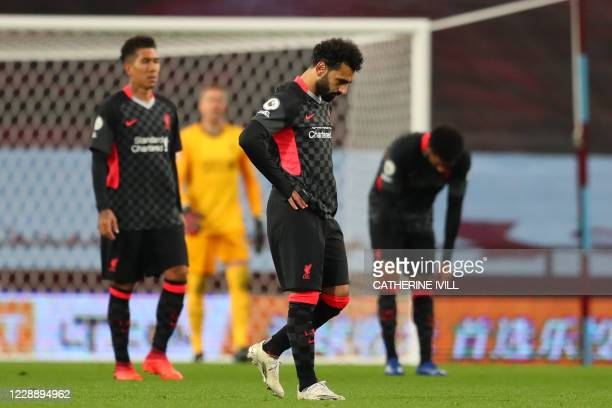 Liverpool's Egyptian midfielder Mohamed Salah and teammates react to conceding their fifth goal during the English Premier League football match...