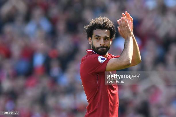 Liverpool's Egyptian midfielder Mohamed Salah applauds fans as he is substituted during the English Premier League football match between Liverpool...