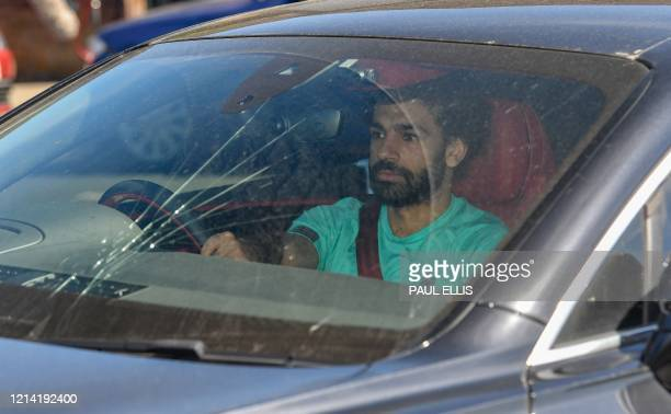 Liverpool's Egyptian midfielder Mohamed Salah arrives at Melwood in Liverpool north west England to resume training on May 20 as training resumes...