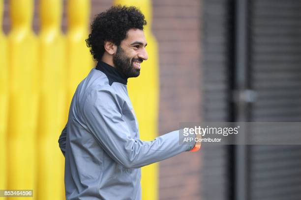 Liverpool's Egyptian midfielder Mohamed Salah arrives for a team training session at the club's Melwood training complex in Liverpool north west...