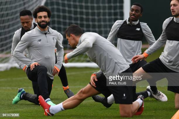 Liverpool's Egyptian midfielder Mohamed Salah attends a team training session on the eve of the UEFA Champions League first leg quarterfinal football...