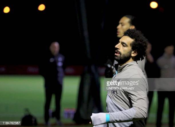 Liverpool's Egyptian midfielder Mohamed Salah attends a training session at Melwood in Liverpool north west England on November 26 on the eve of...