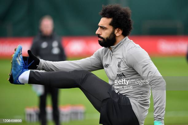 Liverpool's Egyptian midfielder Mohamed Salah attends a training session at Melwood in Liverpool north west England on March 10 on the eve of their...