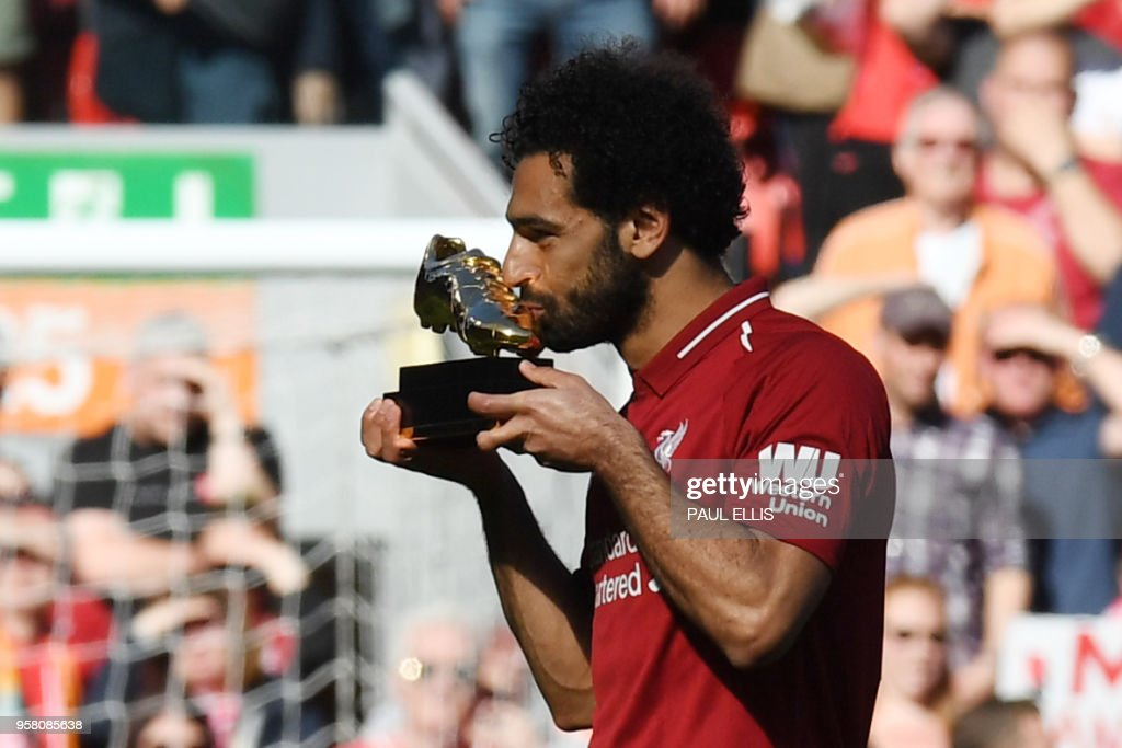 TOPSHOT - Liverpool's Egyptian midfielder Mohamed Salah celebrates after being awarded the golden boot award for most goals scored in the season after the English Premier League football match between Liverpool and Brighton and Hove Albion at Anfield in Liverpool, north west England on May 13, 2018. (Photo by Paul ELLIS / AFP) / RESTRICTED TO EDITORIAL USE. No use with unauthorized audio, video, data, fixture lists, club/league logos or 'live' services. Online in-match use limited to 75 images, no video emulation. No use in betting, games or single club/league/player publications. /