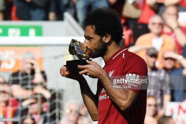 TOPSHOT Liverpool's Egyptian midfielder Mohamed Salah celebrates after being awarded the golden boot award for most goals scored in the season after...