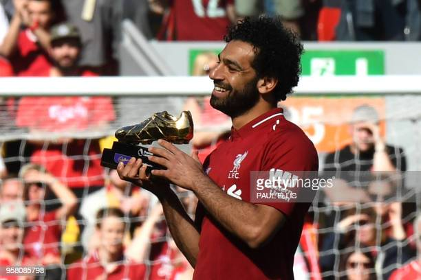 Liverpool's Egyptian midfielder Mohamed Salah celebrates after being awarded the golden boot award for most goals scored in the season after the...