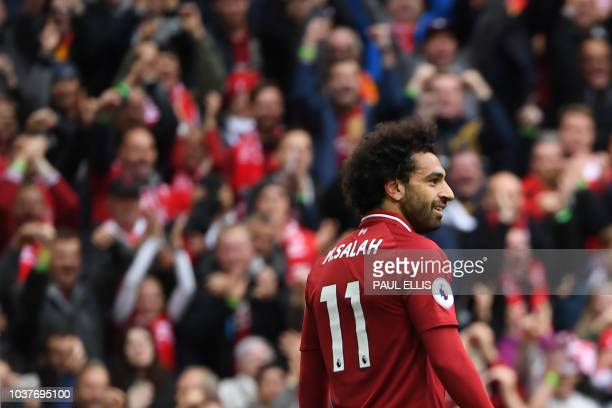 Liverpool's Egyptian midfielder Mohamed Salah celebrates after scoring the team's third goal during the English Premier League football match between...