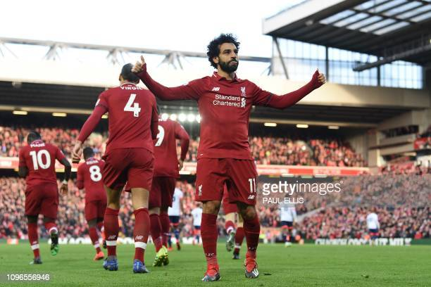 Liverpool's Egyptian midfielder Mohamed Salah celebrates after scoring their third goal during the English Premier League football match between...