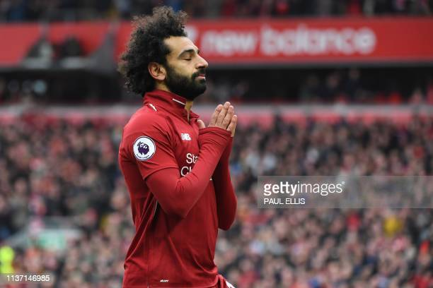 Liverpool's Egyptian midfielder Mohamed Salah celebrates after scoring their second goal during the English Premier League football match between...