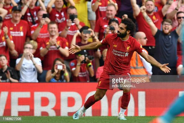 Liverpool's Egyptian midfielder Mohamed Salah celebrates after scoring his second goal Liverpool's third during the English Premier League football...