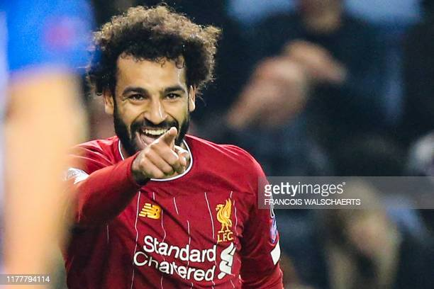 Liverpool's Egyptian midfielder Mohamed Salah celebrates after scoring a goal during the UEFA Champions League Group E football match between Genk...