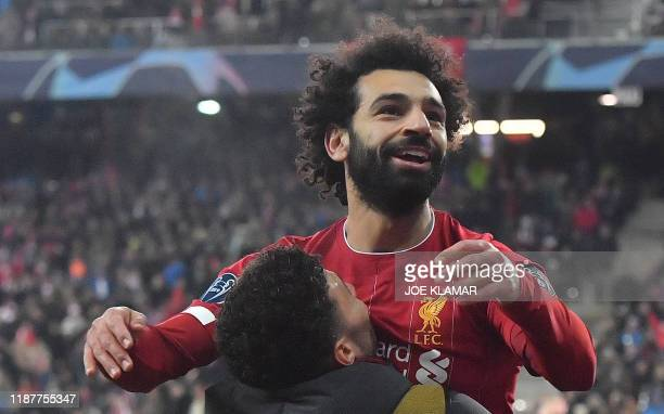 Liverpool's Egyptian midfielder Mohamed Salah celebrates after scoring during the UEFA Champions League Group E football match between RB Salzburg...