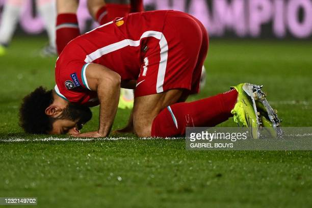 Liverpool's Egyptian midfielder Mohamed Salah celebrates after scoring a goal during the UEFA Champions League first leg quarter-final football match...
