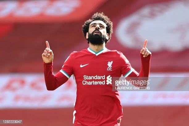 Liverpool's Egyptian midfielder Mohamed Salah celebrates after scoring his team's first goal during the English Premier League football match between...