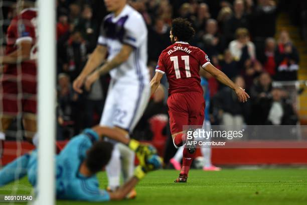 Liverpool's Egyptian midfielder Mohamed Salah celebrates after scoring the opening goal of the UEFA Champions League Group E football match between...
