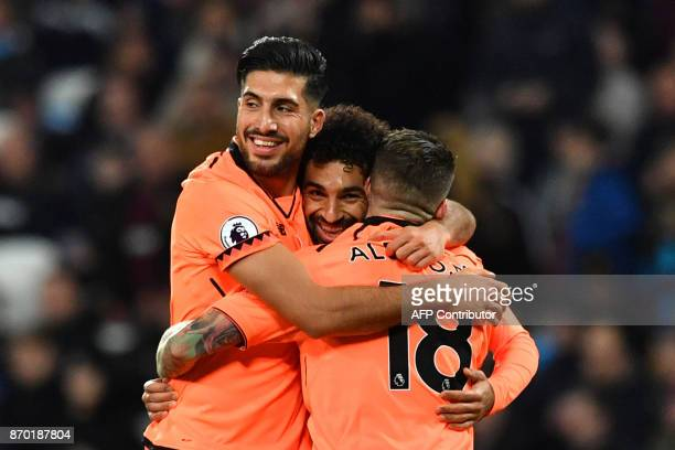 Liverpool's Egyptian midfielder Mohamed Salah celebrates after scoring with Liverpool's German midfielder Emre Can and Liverpool's Spanish defender...