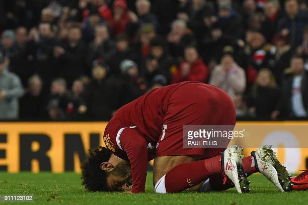 Liverpool's Egyptian midfielder Mohamed Salah celebrates after scoring their second goal during the English FA Cup fourth round football match...